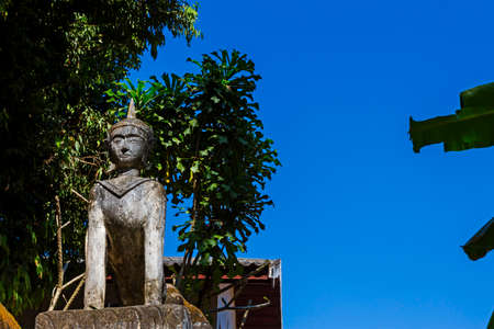 contryside: Ancient statue  with blue sky at Wat Li Hin Luang Lampang, in contryside of Thailand Stock Photo