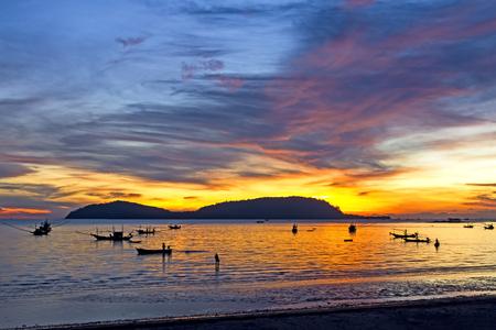 folkways: Dawning and folkways on  Pha Ra Don Phap beach at Chumphon Provice, Thailand