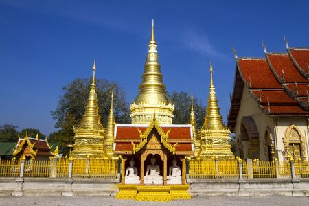 lamphun: Sharp gold and buddha with bue sky at Wat  Phra That  Five Daung, Lamphun Province,Thailand Stock Photo