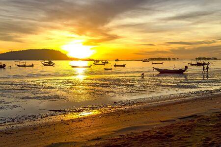 folkways: Sunrise silhouette fishing boat on Pha Ra Don Phap beach at Chumphon Provice, Thailand Stock Photo
