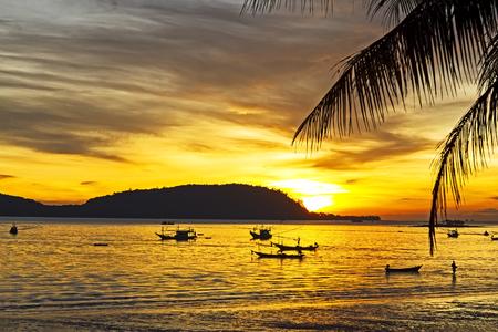ra: Sunrise silhouette  dawning on Pha Ra Don Phap beach at Chumphon Provice, Thailand Stock Photo