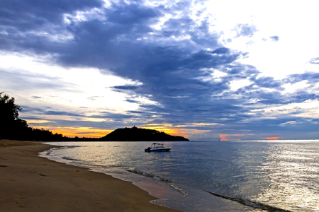 dawning: Dawning silhouette boat on Ban Krut Beach at Prachuap Khirikhun Province, Thailand Stock Photo