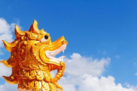 chum: Beautiful head dragon with blue sky at Wat Pra That Choeng Chum, Sakon Nakhon Thailandlnd