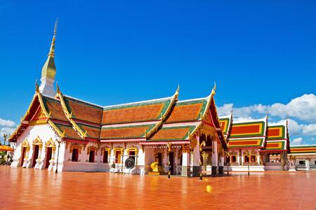 chum: Idyllic architecture with blue sky at Wat Pra That Choeng Chum, Sakon Nakhon Thailandlnd Stock Photo
