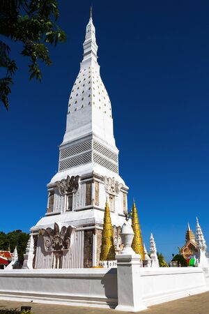 dyllic: Chedi white PraThat Tha Uthen with blue sky , at Nakorn Phanom province Thailand
