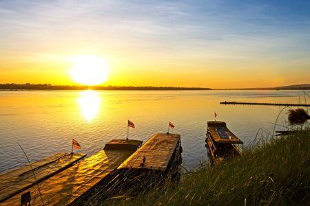 riverside county: The ship and sunrise at  Mekong River, Mukdahan county,Thailand
