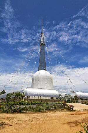 White architecture and blue sky with pagoda in  Chumphon province Thailand.