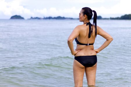 hua: Woman with black bikini show beautiful on beach at Ban Krut Beach, Prachuap Khirikhan Province Thailand Stock Photo