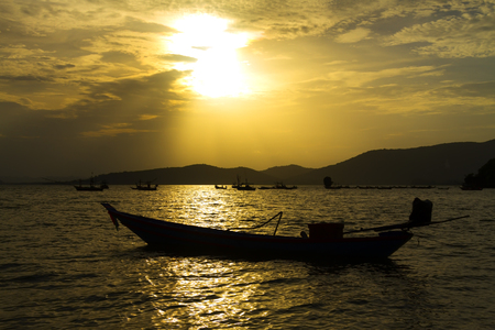 Sunset and small boat atl Cumphon Province Thailand is famous for travel