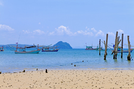 Beach with sky and fishing boat at Bang Boet beach at Chumphon Province Thailand is famous for travel Фото со стока