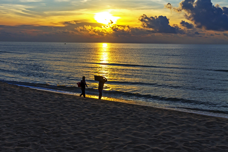Sunrise and two fisherman at the beach Ban Krut Beach, in Prachap Kirikhun Province Thailand is famous for travel