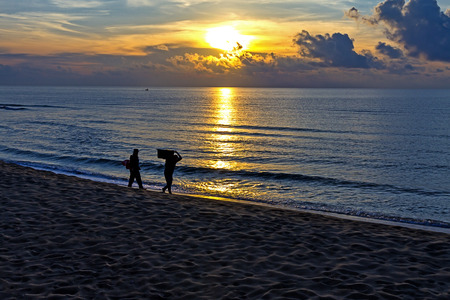Sunrise and shadow peple at the beach Ban Krut Beach, in Prachap Kirikhun Province Thailand is famous for travel 版權商用圖片