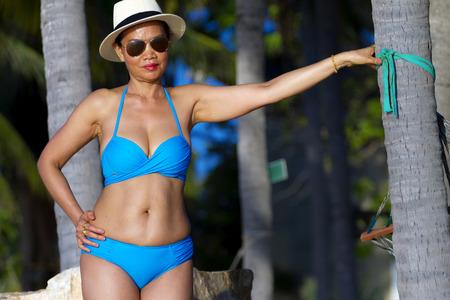 Woman with bikini blue beautiful sunshine morning at the beach Ban Krut Beach, in Prachap Kirikhun Province Thailand is famous for travel