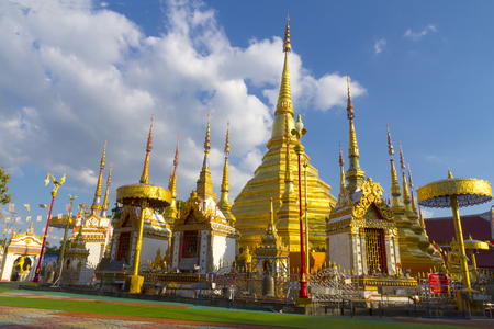 Pagoda goold and blue sky beautiful with cloud at Wat Phra Bat Ban Tak, Tak Province, of Thailand
