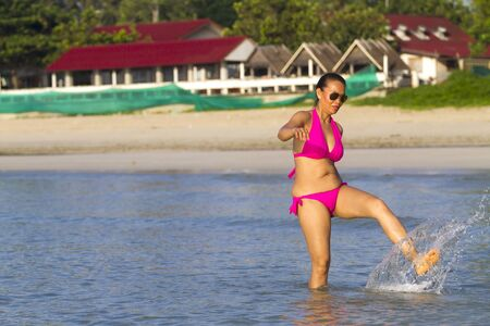 Woman body pretty relax on beach with pink bikin at Thung Wua Laen Beach, Chumphon Province Thailand