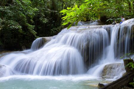 Erawan Waterfall is waterfall famous in green forest of Kanchanaburi province, Thailand Imagens