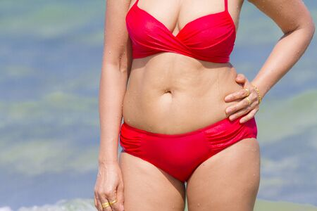 Woman shape pretty with red bikini on beach at Ban Krut Beach, in Prachuap Kirikhun Province Thailand is famous for travel