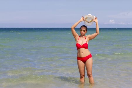 Woman body beautiful with red bikini on beach at Ban Krut Beach, in Prachuap Kirikhun Province Thailand is famous for travel 写真素材