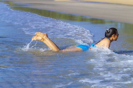 Woman and bikini blue show happy enjoy at the beach Ban Krut Beach, in Prachuap Kirikhun Province Thailand is famous for travel 写真素材