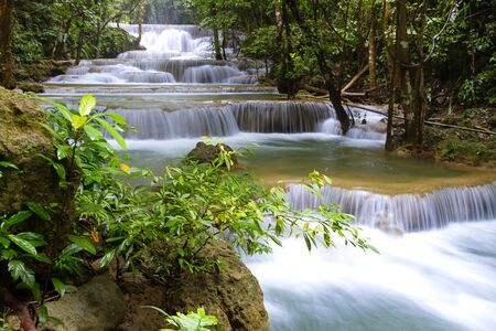Huai Mae Khamin waterfall after the rain beautiful with natural in Kanchanaburi province Thailand.Huai Mae Khamin waterfall is in rain forest and tree green 版權商用圖片
