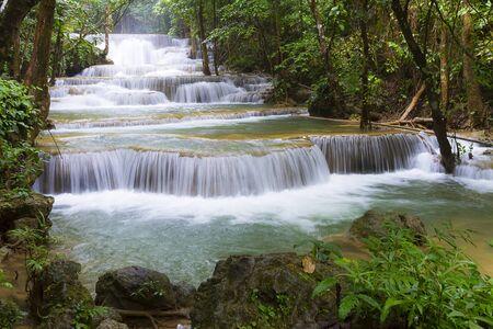 Huai Mae Khamin waterfall after the rain idyllic with natural in Kanchanaburi province Thailand.Huai Mae Khamin waterfall is in rain forest and tree green