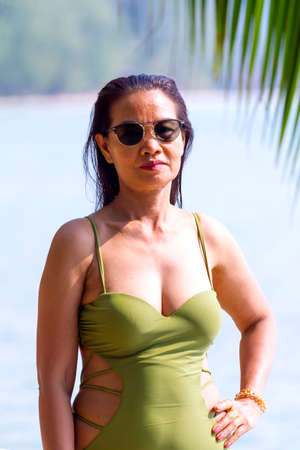 Woman traveler beautiful in swimsuit at beach Koh Chang Thailand.Koh Chang is located in the eastern Gulf of Thailand. It is an island with beautiful nature. Famous for tourism