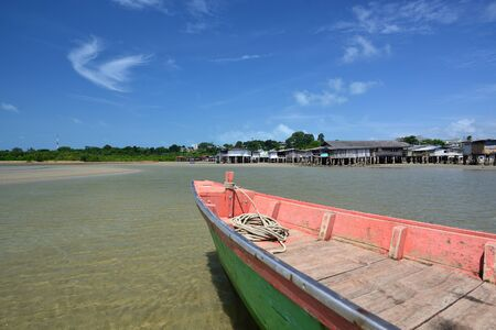 Fishing village and fishing boat.The traditional way of life of indigenous fishermen. Stock Photo
