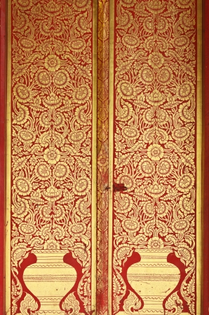 carved temple door of Wat Chiang Man at chiangmai, Art temple in Thailand photo