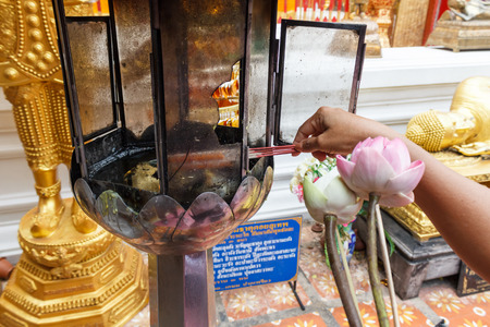 candles for buddhism worshiping of Wat at chiangmai , Art of Thai style window at temple in Thailand photo