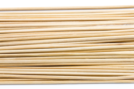 small wood stick isolated on white background, front view from the top, technical cost-up.