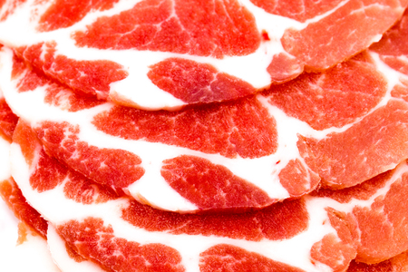 Close-up sliced raw pork isolated on white background. It copy space and selection focus. Foto de archivo - 97330840