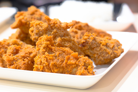 chicken fried isolated on white background, front view from the top, technical cost-up. Stock Photo