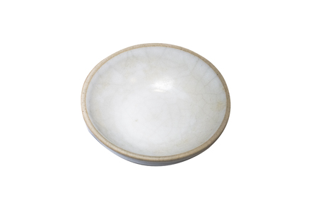 White dish isolated on wood background.Closed up.Clipping path Stock Photo