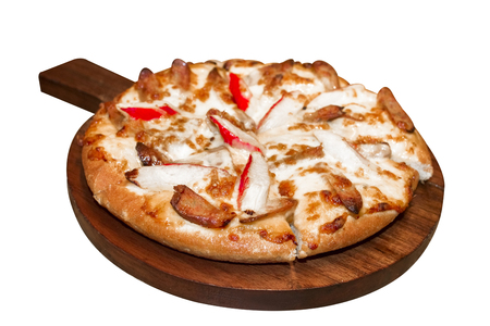 Fast food italian traditional.Hot chicken sausage pizza with cheese, imitation crab stick on wooden board table classic in top view.Closed up.Copy space. Stock Photo