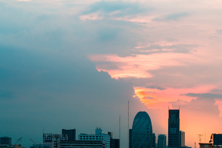 Bird view over cityscape with sunset and clouds in the evening.Copy space.Bangkok.Pastel tone.
