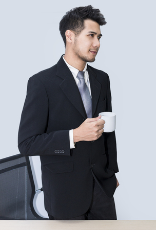 Young handsome businessman smiling and thinking at office .Copy space.