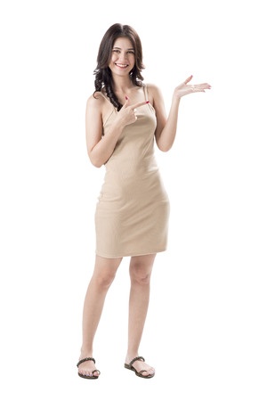 Cheerful young woman caucasian wearing light dress standing and posing on isolates white background.Lady joyful and charming smile.