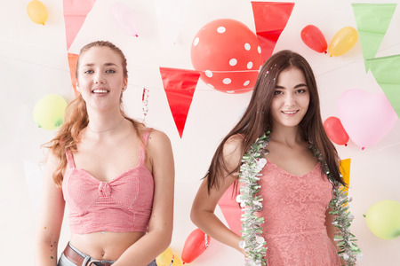 Young beautiful women celebrate holiday party and dancing.Best friends wearing dress,casual shorts and T-shirt,having fun in holiday.Pastel tone. Archivio Fotografico