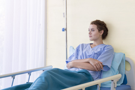 Attractive young woman patient thinking and dream about life on hospital bed.Copy space.