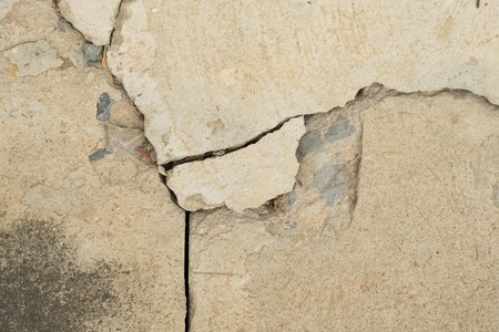 earthquake crack: Cracked concrete texture closeup background