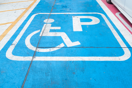 Logos for disabled on parking. handicap parking place sign Stock Photo