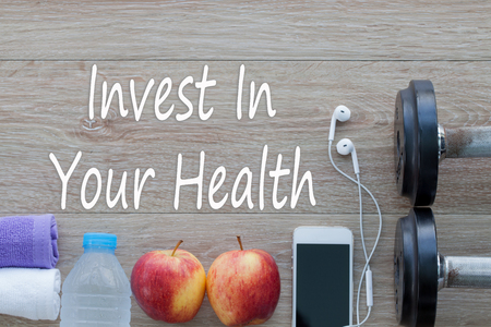 Invest in your health , Healthy lifestyle concept with diet and fitness , Get fit in this year, fitness equipment and healthy food.
