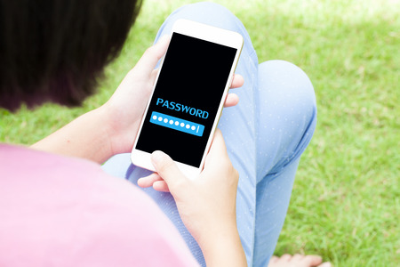 Top view of woman using her mobile phone with password screen with copyspace. Stock Photo
