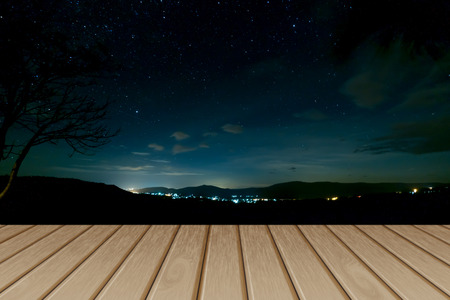 Empty wooden floor nature background night sky. Can be used for display or montage your products. Stock Photo