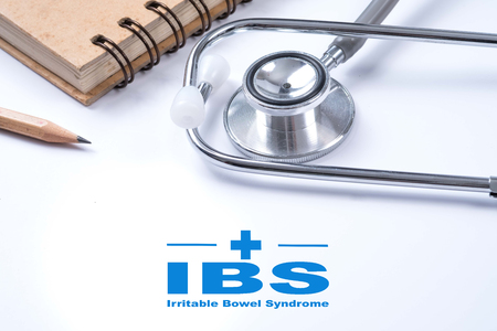 bowel disorder: Stethoscope, notebook and pencil with IBS (Irritable Bowel Syndrome),  Medical concept.