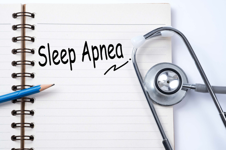 somnambulism: Stethoscope on notebook and pencil with sleep apnea words as medical concept Stock Photo