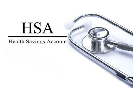 Page with HSA (Health Savings Account) on the table with stethoscope, medical concept Stockfoto