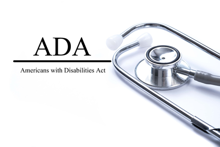 Page with ADA (Americans with Disabilities Act) on the table with stethoscope, medical concept. Stockfoto