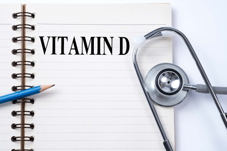 Stethoscope on notebook and pencil with VITAMIN D words as medical concept. Imagens - 78906988