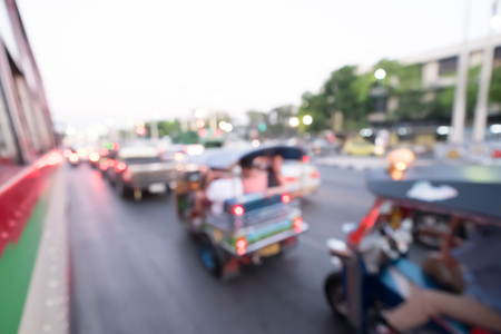 autorick: Blur Tuk Tuk in Bangkok take pictures from the buses in traffic jam. Auto rickshaw. Stock Photo